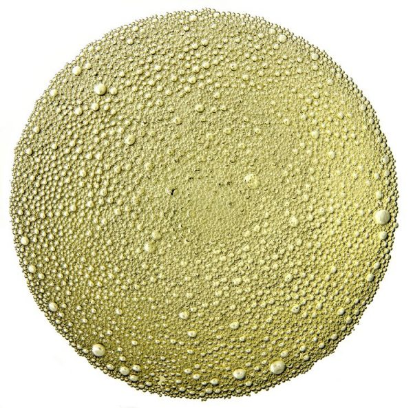 The world is Champagne. An aerial view of the bubbles in a wine glass.
