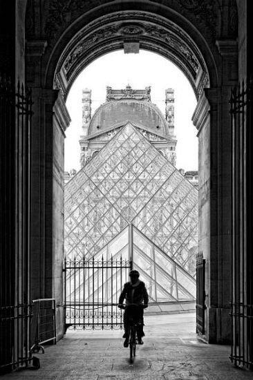 Architecture Louvre bicyclist in Paris.
